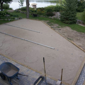 Sub-grade is level using MAKO FinCap screed chairs for pavers on deck